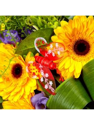 Букет цветов из голубой фрезии, желтой герберы, белого орнитогалума и теласпии №36 с доставкой.